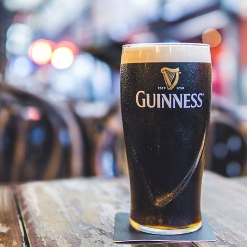 A glass of dark colored guinness
